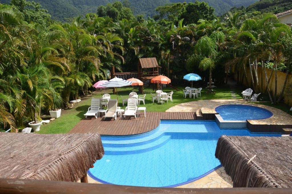 A view of the pool at Pousada Mar Deny Maresias or nearby