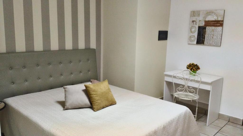 Letto o letti in una camera di Hotel Sirio