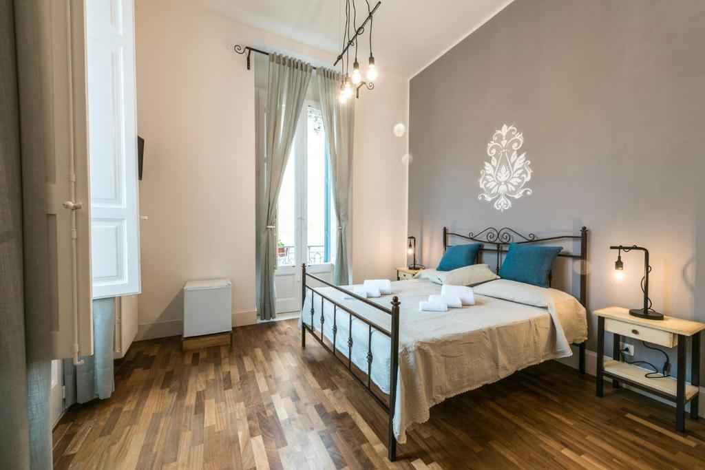 A bed or beds in a room at Dimora dell'Artista