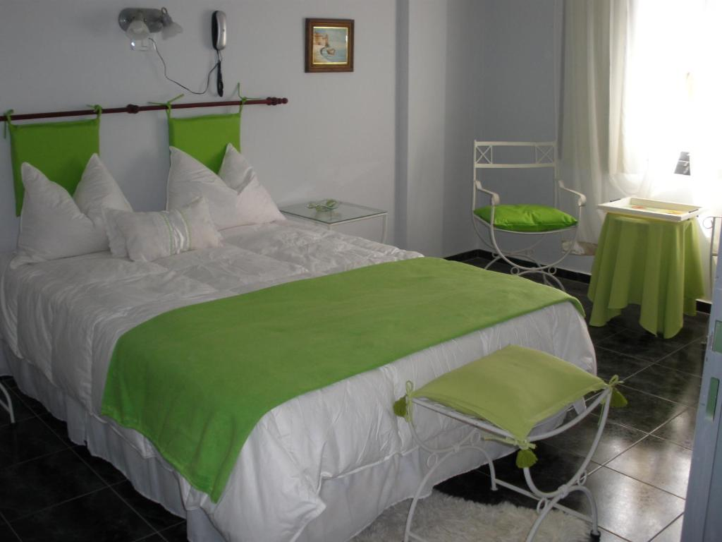 A bed or beds in a room at Noria Hotel