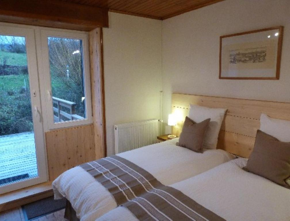 """A bed or beds in a room at Chambre d'hôtes """"Lumière et Quiétude"""""""