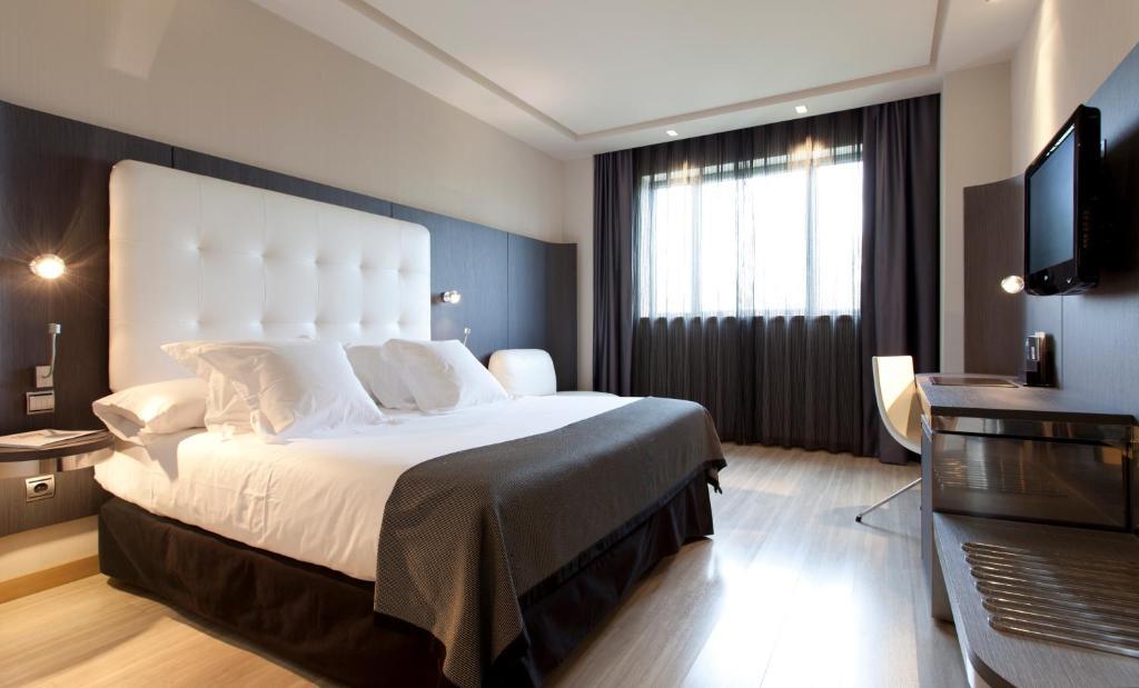 Ein Bett oder Betten in einem Zimmer der Unterkunft Hotel Maydrit Airport