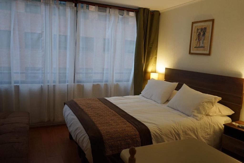 Cama o camas de una habitación en Encomenderos Apart Hotel