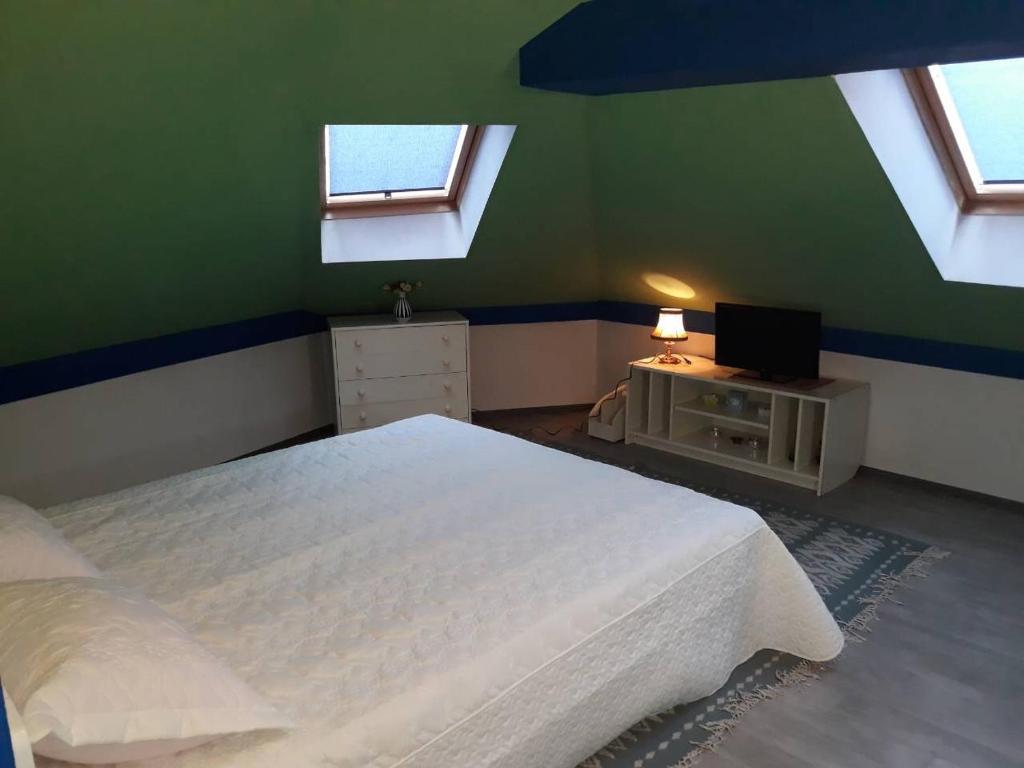 Krevet ili kreveti u jedinici u okviru objekta Guesthouse Center