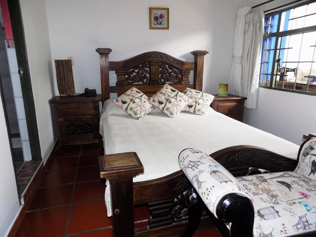 A bed or beds in a room at Hotel Antigua Belen