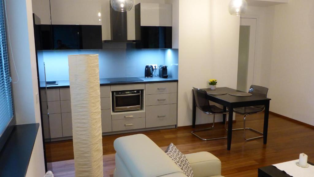 A cozinha ou cozinha compacta de Apartment UMM
