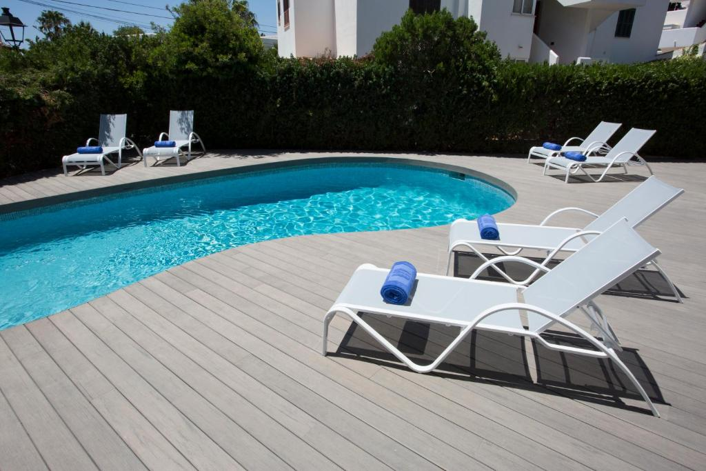 The swimming pool at or near Ferrera Suites