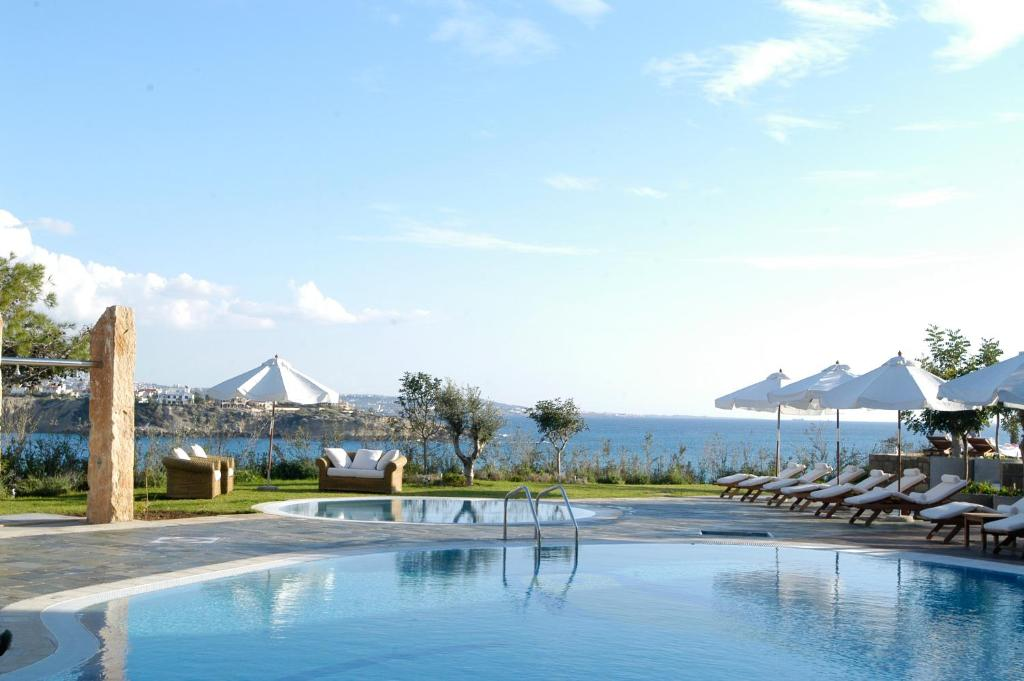 The swimming pool at or near Coral Thalassa Hotel