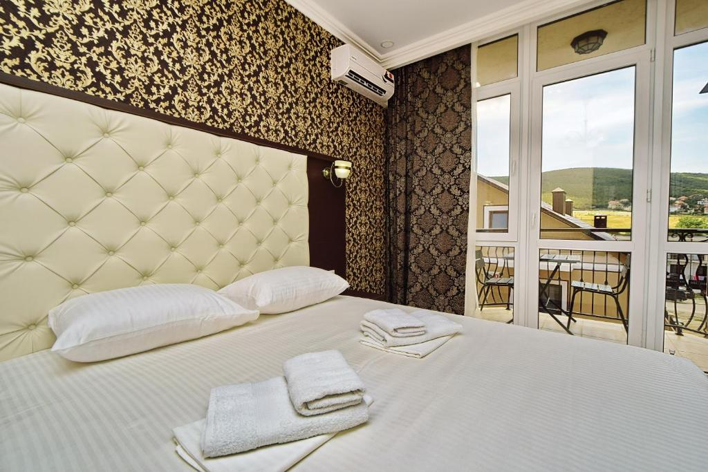 A bed or beds in a room at AsTerias Hotel