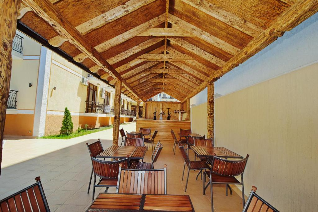 A restaurant or other place to eat at AsTerias Hotel