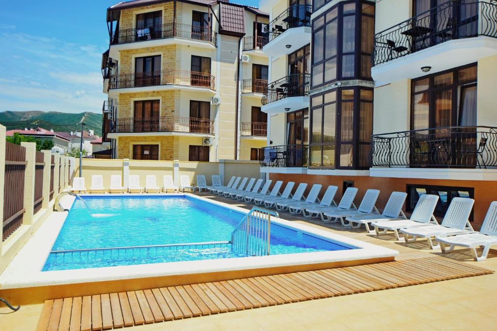 The swimming pool at or near AsTerias Hotel