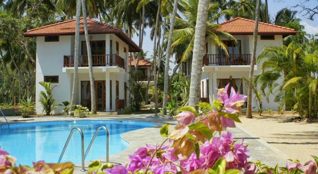 The swimming pool at or close to Good Karma Ayurvedic Resort
