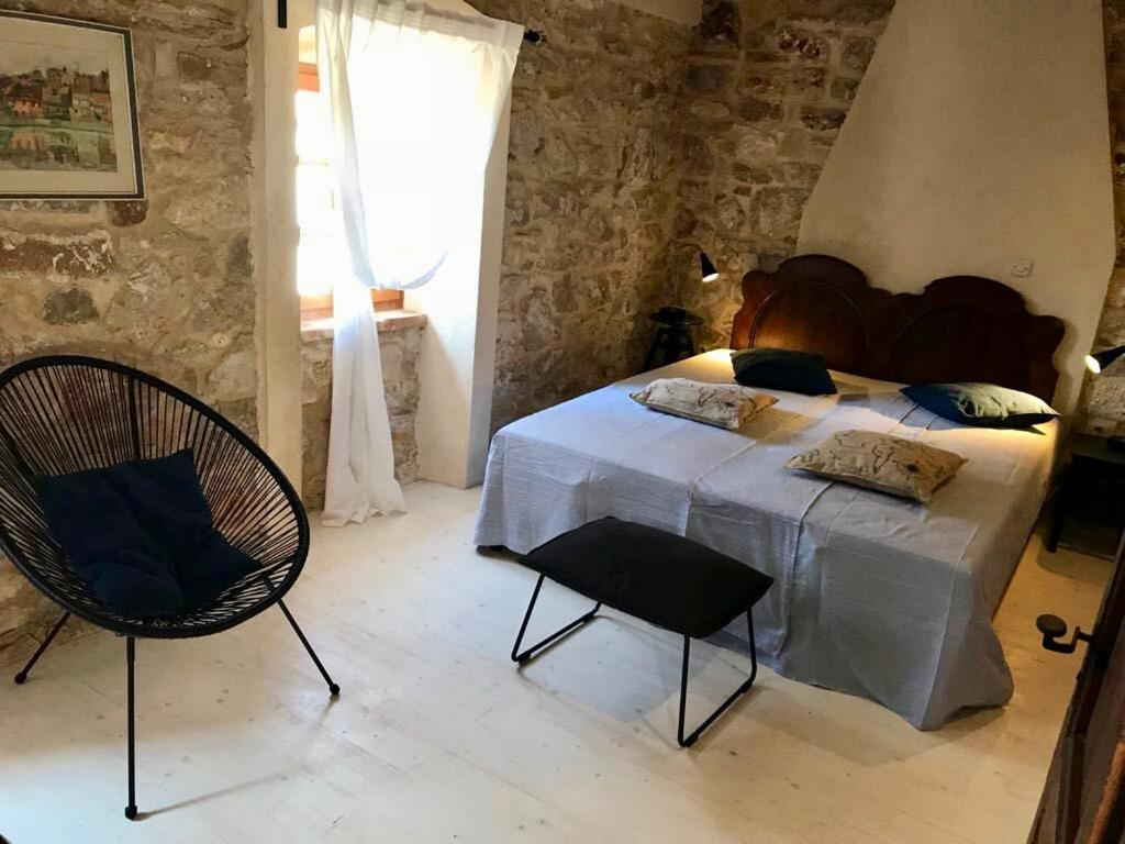 A bed or beds in a room at Holiday Homes Susak Sansego
