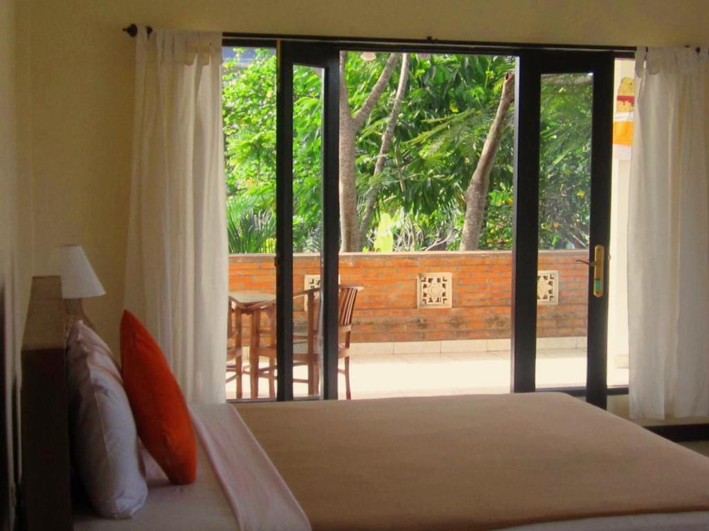 Cama ou camas em um quarto em Purnama di Bisma