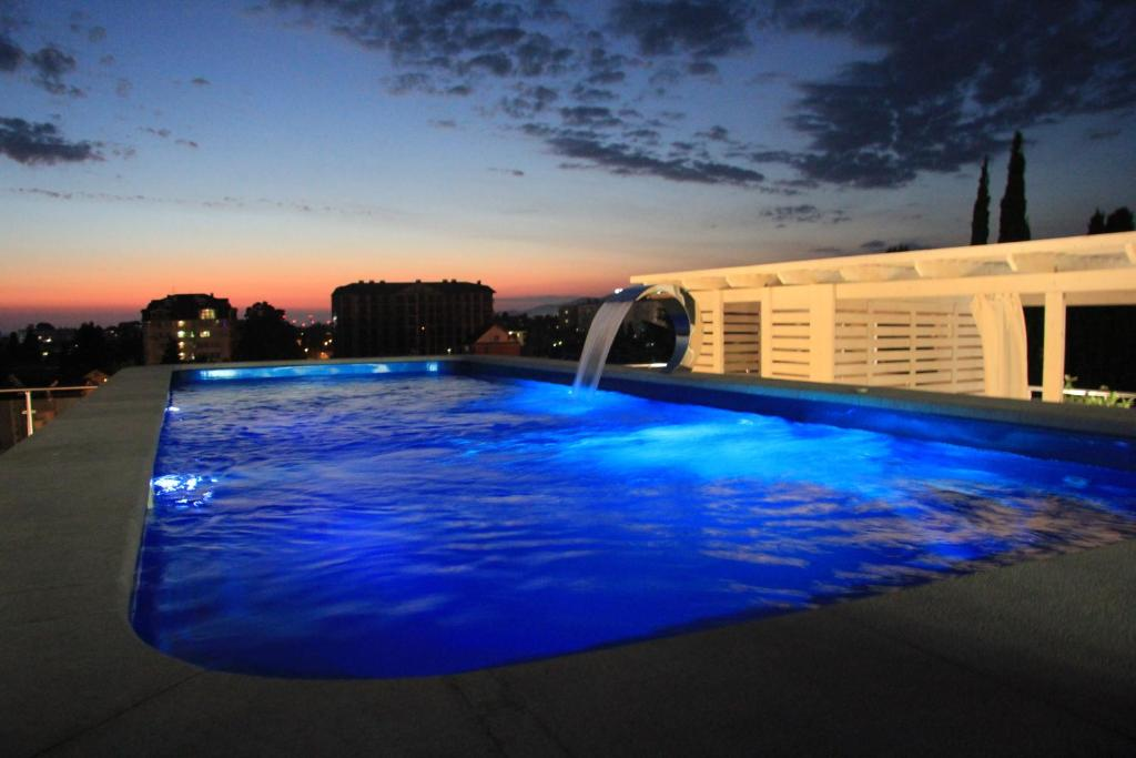 The swimming pool at or near Forward Aparthotel