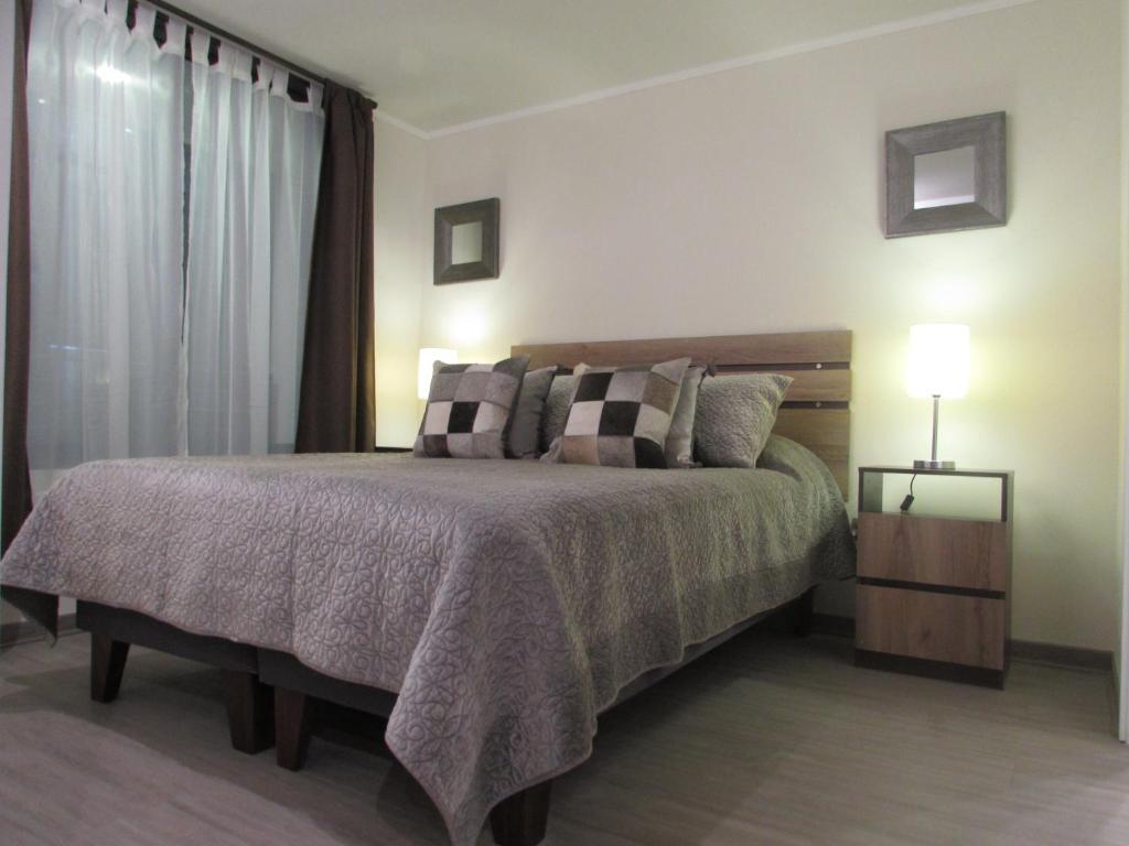 Cama o camas de una habitación en Santiago Central Suites / San Martin