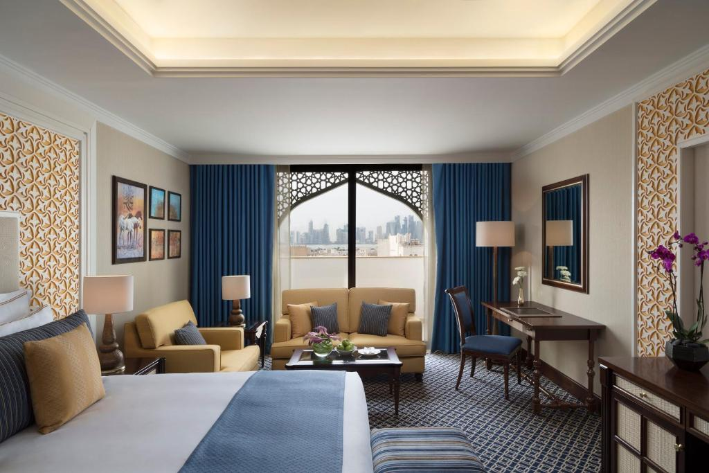 A seating area at Al Najada Doha Hotel by Tivoli