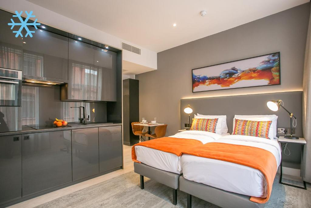 A bed or beds in a room at Grafton Street Studios