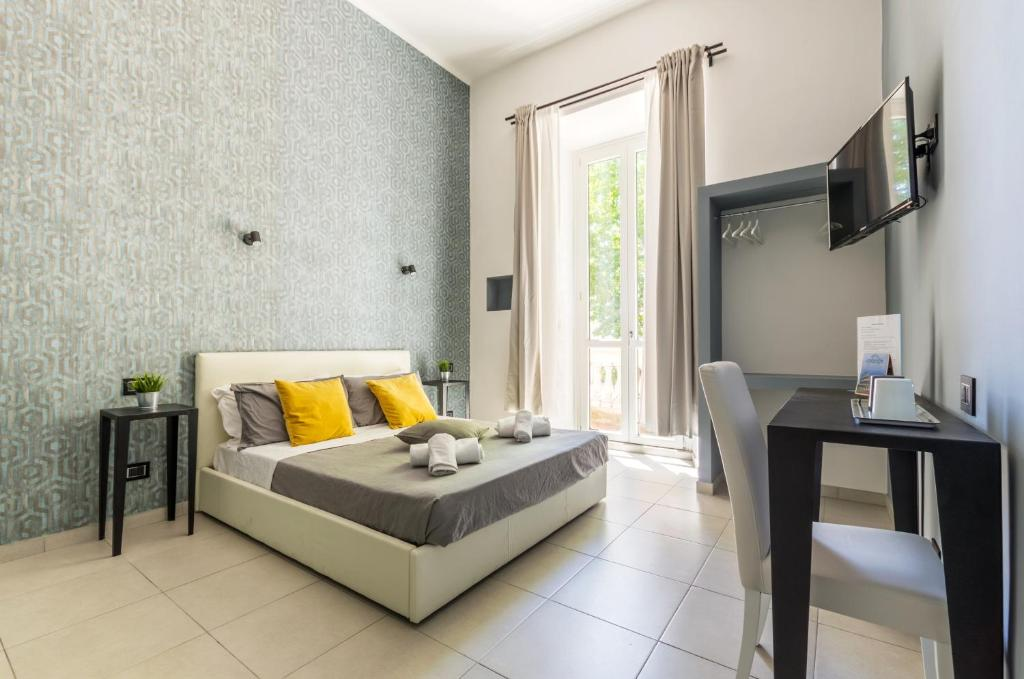 A television and/or entertainment center at Merulana 139 Suites