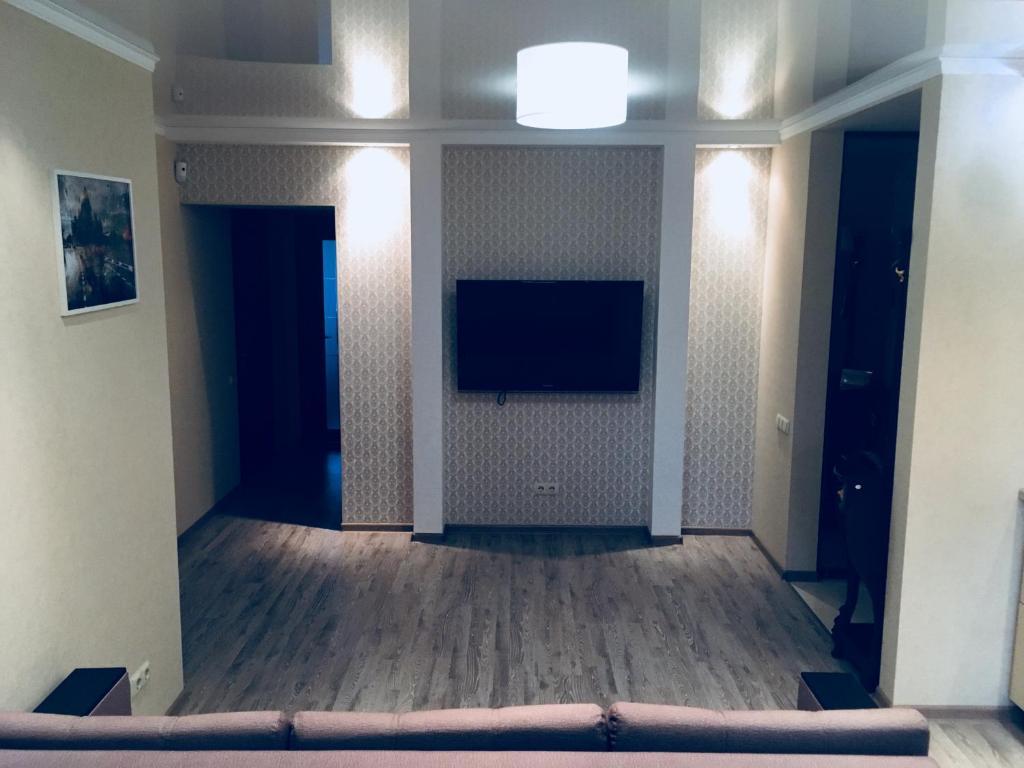 Телевизор и/или развлекательный центр в Apartment Plus