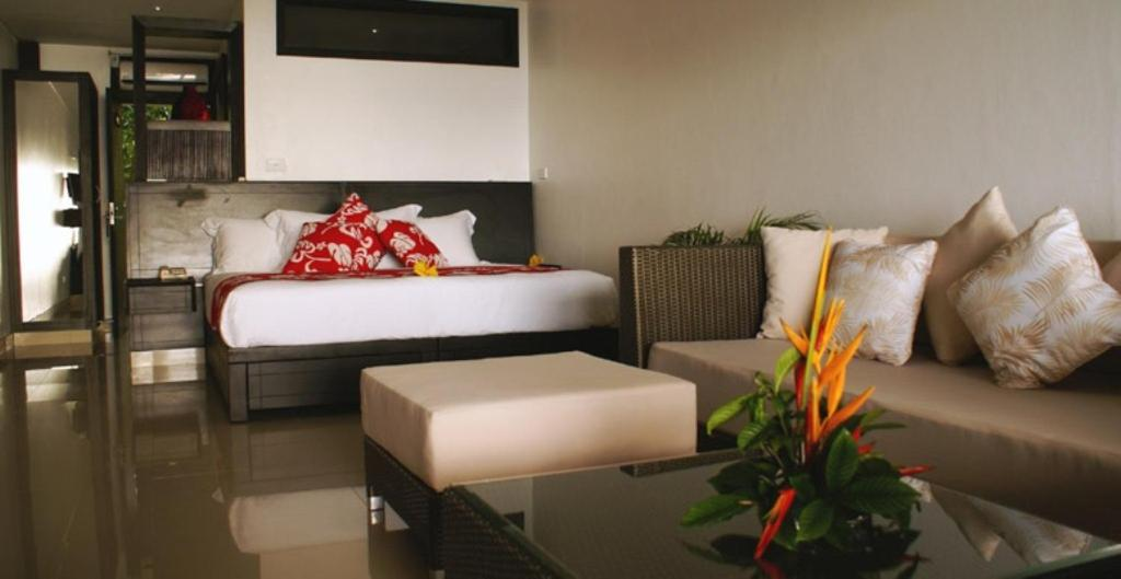 A bed or beds in a room at Garden Island Resort