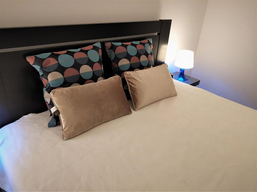 Letto o letti in una camera di Sleep & Go Faro Airport Guest House