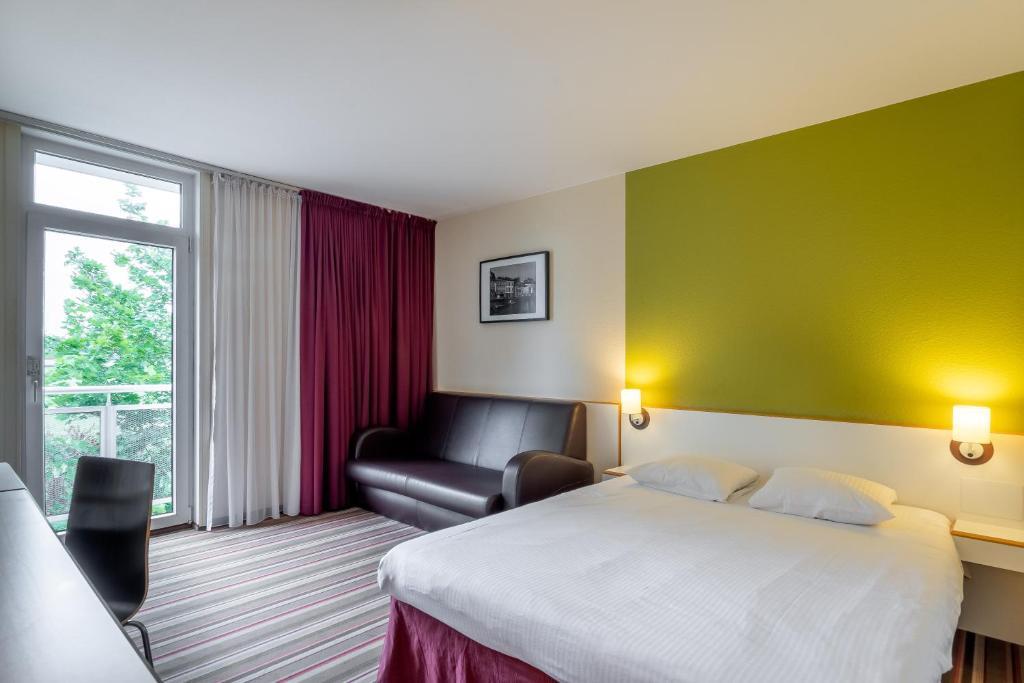 Een bed of bedden in een kamer bij Green Park Hotel Brugge