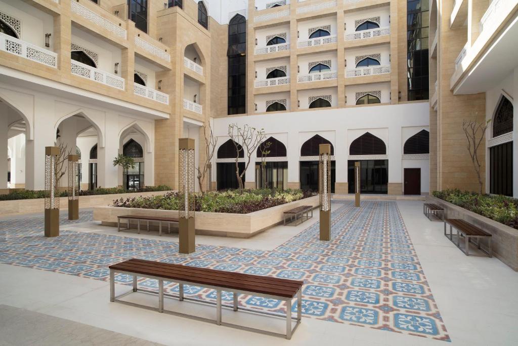 The swimming pool at or near Al Najada Doha Hotel Apartments by Oaks