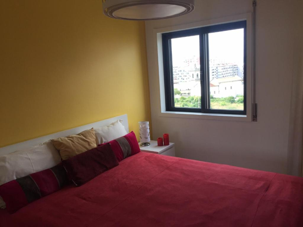 A bed or beds in a room at Appartement de standing