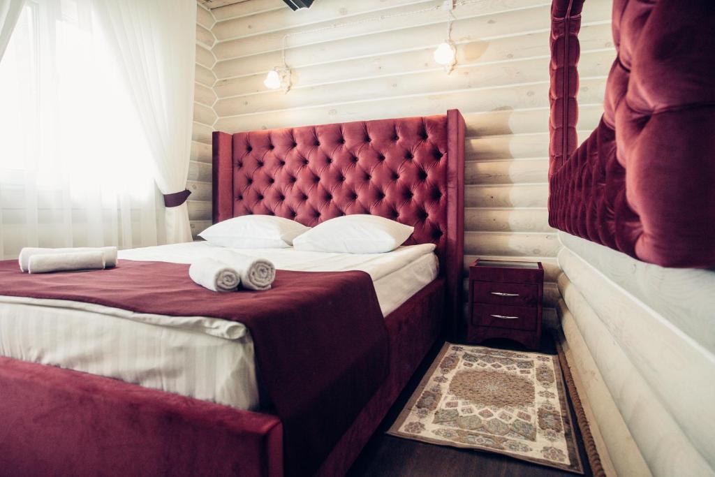 Кровать или кровати в номере Агроусадьба Подсолнух