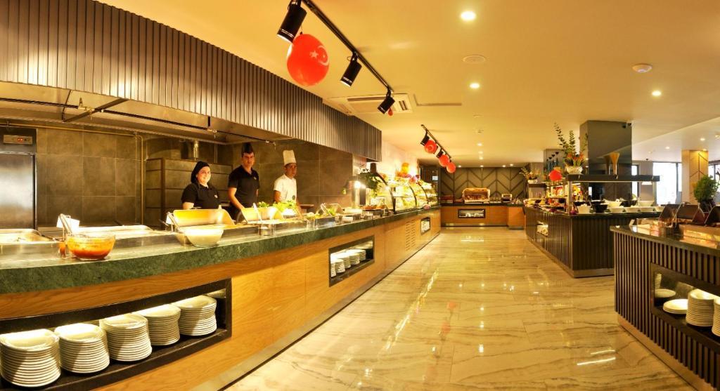 Кухня или мини-кухня в Oba Star Hotel - Ultra All Inclusive