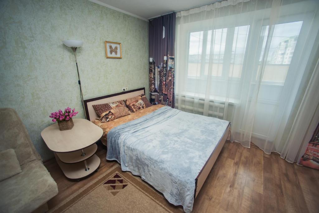 Кровать или кровати в номере Апартамент от Татьяны 3