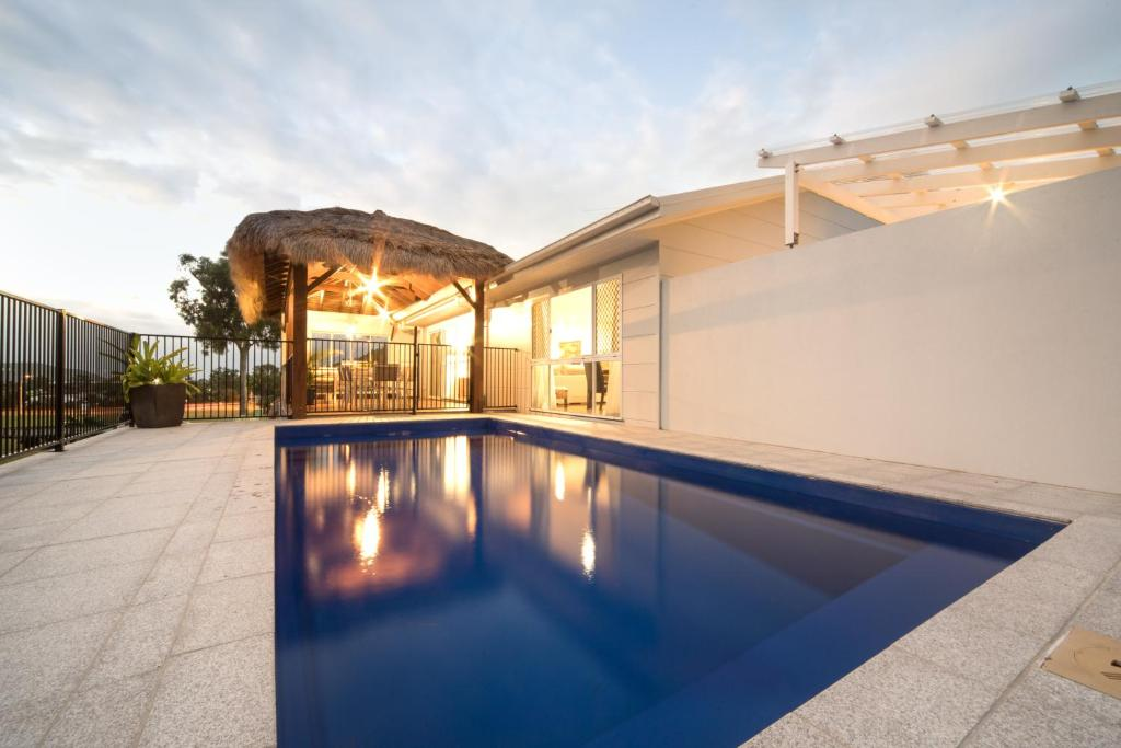 The swimming pool at or near Whitsunday Luxury Homes