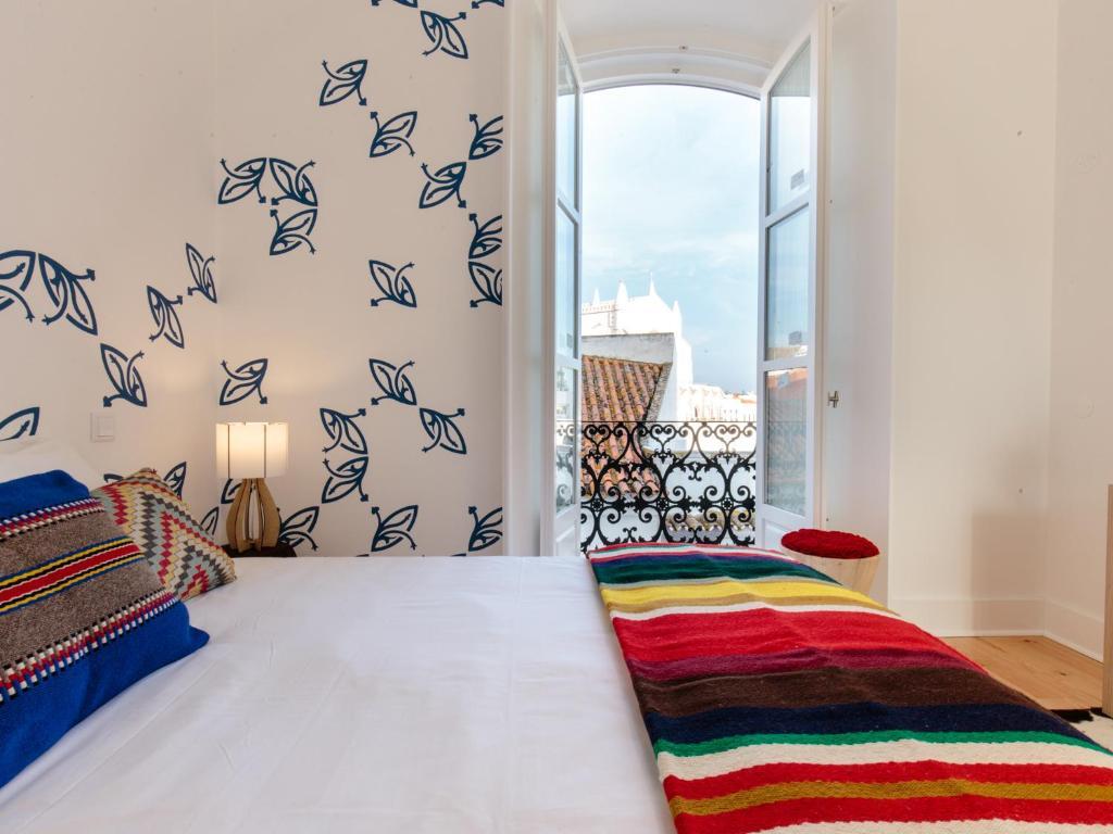 Katil atau katil-katil dalam bilik di Heaven Inn Évora