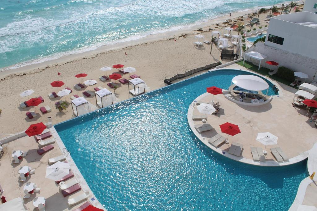 A view of the pool at Bel Air Collection Resort and Spa Cancun or nearby