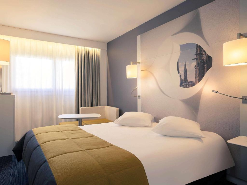 Een bed of bedden in een kamer bij Mercure Metz Centre