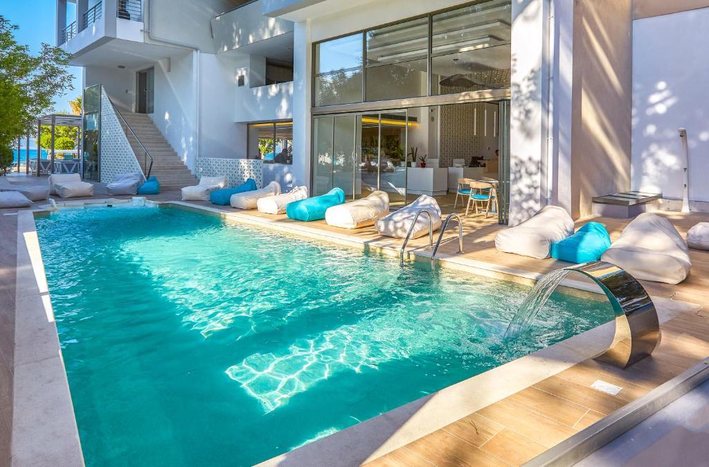 The swimming pool at or near Triton Hotel