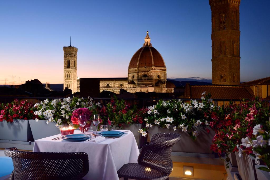A restaurant or other place to eat at San Firenze Suites & Spa