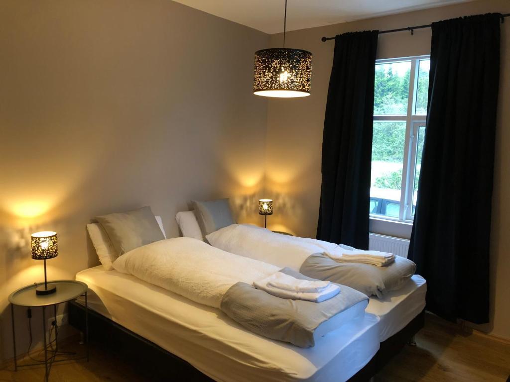 Een bed of bedden in een kamer bij Bjork Guesthouse