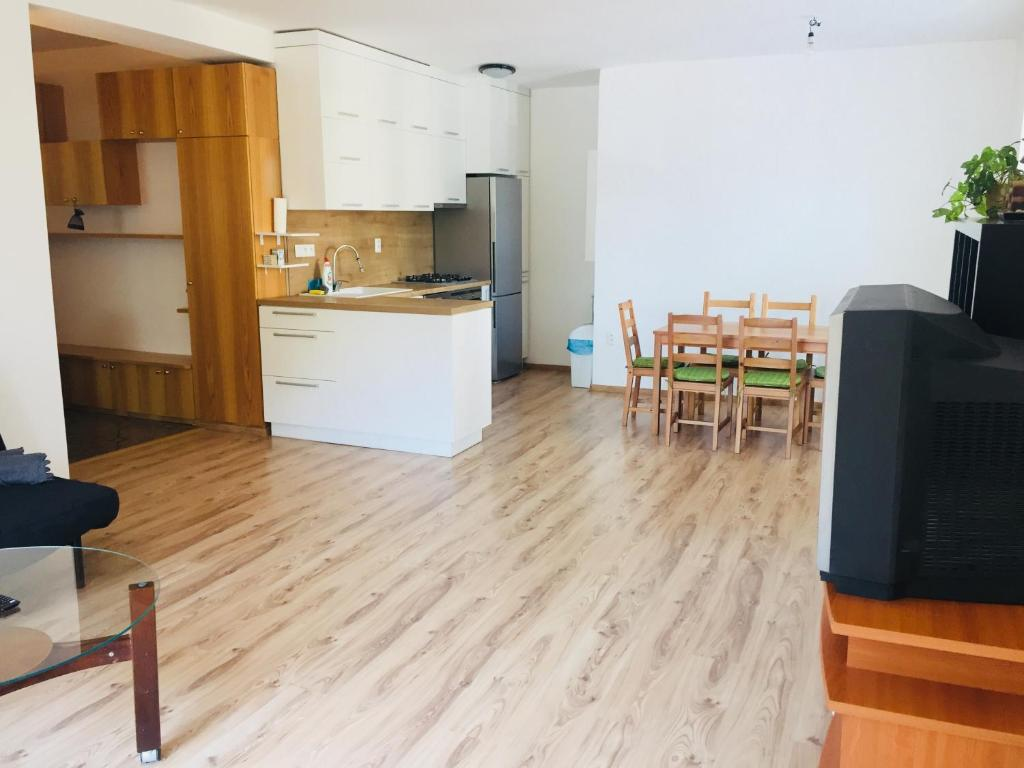 A kitchen or kitchenette at Beautiful apartment in the heart of our city