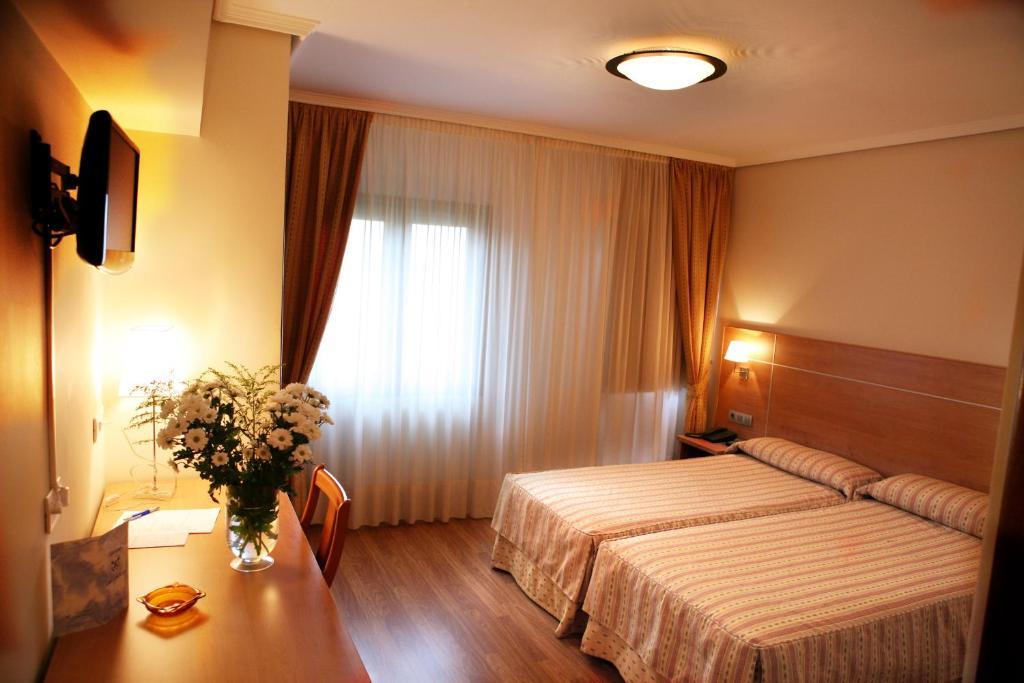 Cama o camas de una habitación en Hotel Las Anclas
