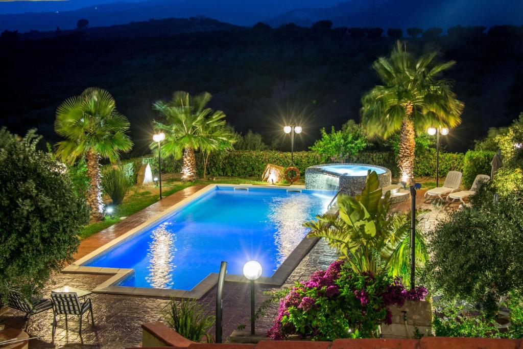 The swimming pool at or near B&B Le Foglie D'Argento