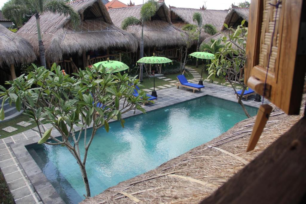 The swimming pool at or near The Calmtree Bungalows