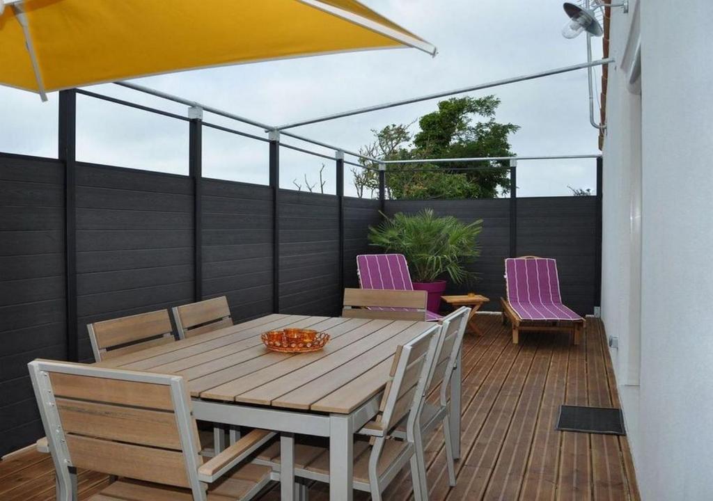 A balcony or terrace at CotiLoft - Appartement de standing La Cotinière
