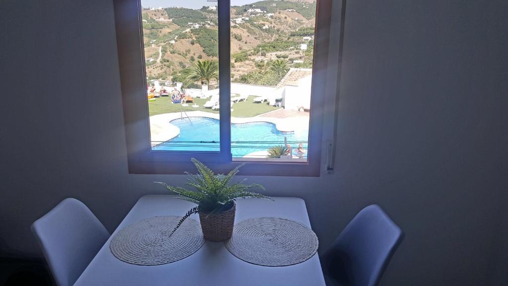 A view of the pool at Coqueto apartamento en el centro de Frigiliana or nearby