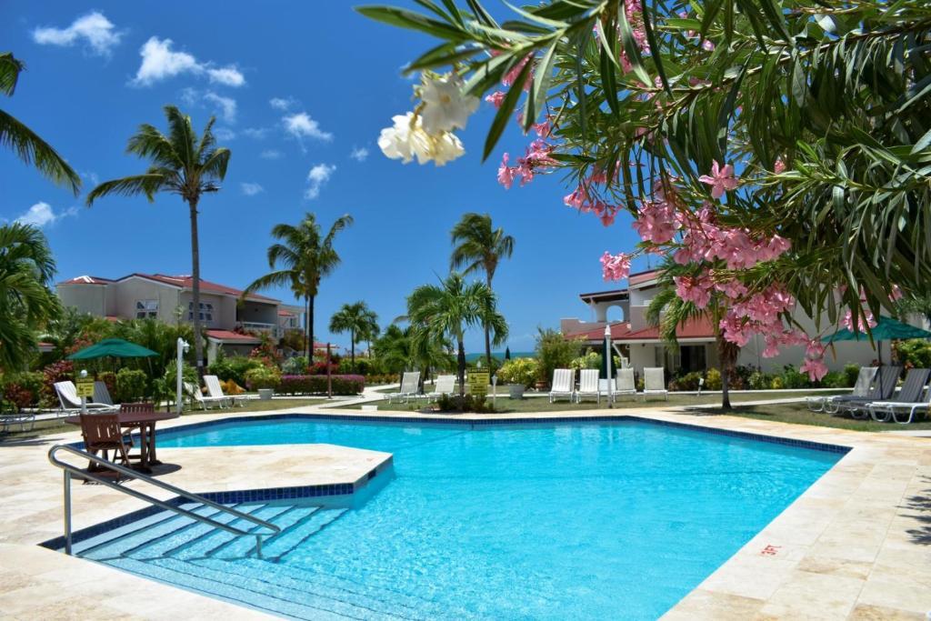 The swimming pool at or near Antigua Village Beach Resort