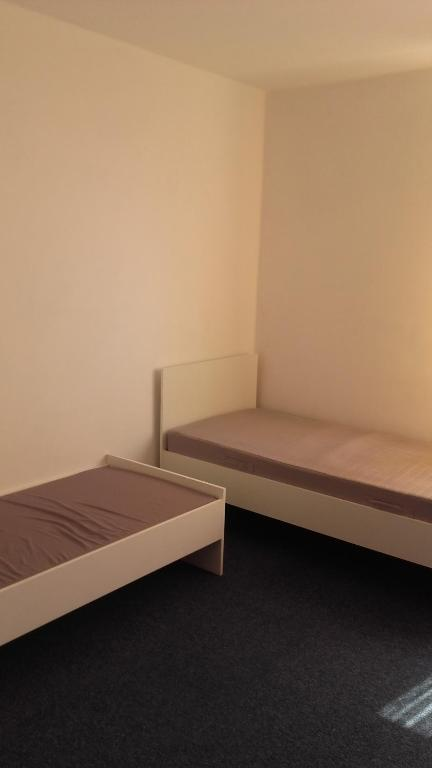 A bed or beds in a room at Óbudai Apartman