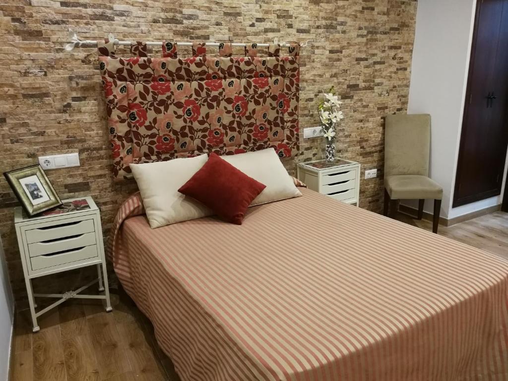 Un ou plusieurs lits dans un hébergement de l'établissement Hostal Maestre