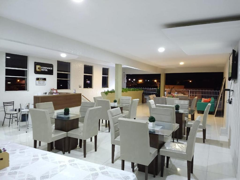 A restaurant or other place to eat at Confiance Hotel
