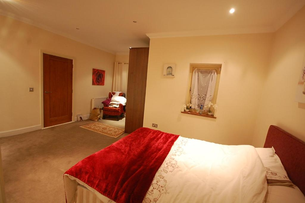 A bed or beds in a room at Ninth Lough Suite